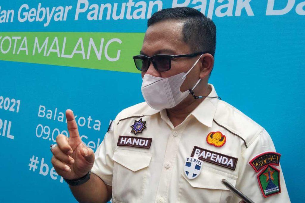 Kepala Bapenda Kota Malang jelaskan inovasi OPDnya. (ws1) - Bapenda Launching Pelayanan Publik Berbasis Elektronik e-SPPT PBB - Diikuti launching pelayanan publik oleh Dishub, Dispendukcapil dan Disporapar